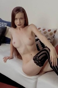 Soft skinned ginger Emily Bloom posing naked wearing only black stockings