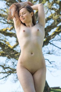 Lonely brunette Via is having fun outdoors in nature without any clothes