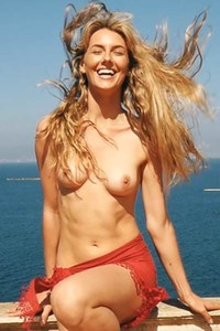 It is just a beautiful day for Jennifer Love to enjoy the sunshine in nude