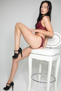 Astonishing black haired girl Leanne Lase bends over to show us her tight ass