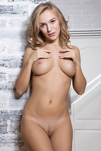 Mesmerizing blonde doll with perfect smooth body delightfully poses naked