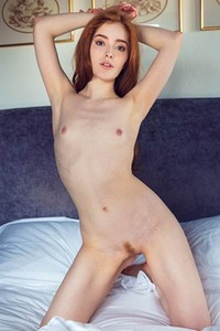 Ginger cutie Jia Lissa spreads her legs showing her pink pussy