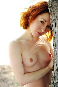 Redhead hottie Night A exposes her young petite body outdoor