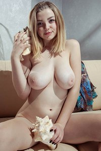 Sweet blue eyed angel Daniel Sea takes off her dress and bares her massive melons