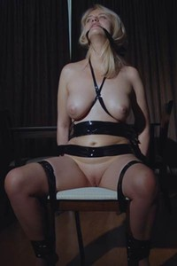 Irresistible blonde chick Mary Lin strips naked and bonds her body with tape