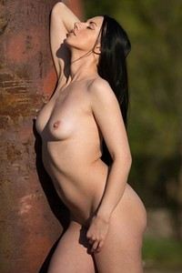 Dark haired seductress Veronica Snezna presents her sexy naked body outdoor