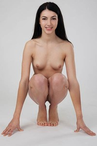 Young doll Moka T poses naked and presents her fresh body with a teasing smile on her face