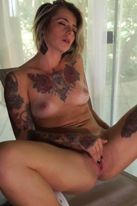 Pretty tattooed chick Samira is feeling hot and horny at home