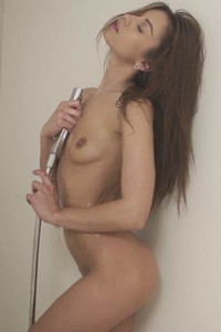 Extremely hot brunette is taking a naughty shower in front of camera