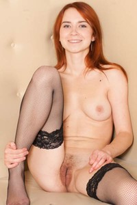Ginger bomb Kelly G loves getting naked and posing like she is addicted