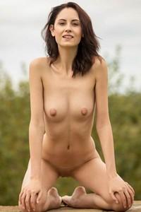 Skinny brunette Sabrina G shows off her naked body outdoors