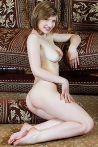 Elegant pale skinned vixen Mariam spread her legs to show us her tasty hairy pussy