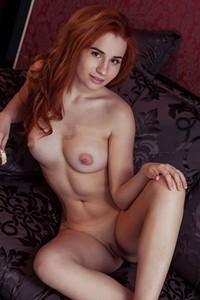 Redhead bombshell sensually poses naked showing us her all natural pale body