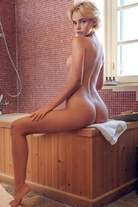Short haired blonde gets naked making us horny with her solo performance