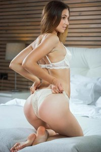 Astonishing brunette poses naked in her bedroom showing us her perfectly shaped ass