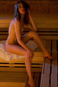 Slim fit brunette Vi Shy poses naked in sauna showing us her wet pussy