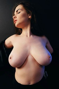 Incredibly hot busty doll takes off her leather jacket to show us her magnificent big breasts