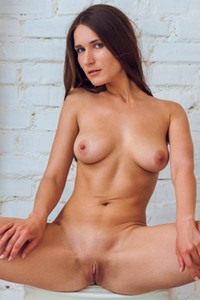 Amazing brunette is not shy to present us her all natural body with passion