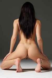 Dark haired goddess Grace spreads her legs on the floor and shows off her yummy pussy