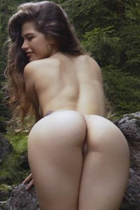 Irene Rouse is on her secret place in the woods masturbating on the big rock