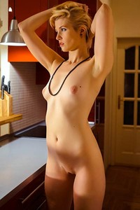 Charming blonde Mikeala goes all the way in this superb undressing solo action