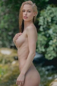 Big titted blonde Miss Zita seduce us posing naked presenting us her stunning body with passion