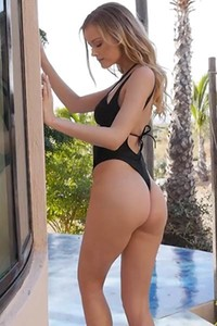 Seductive young blonde looks so sexy in the tight black bikini