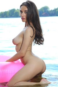 Top class babe Gloria Sol takes off her sexy bodysuit and poses on the pink lifebuoy