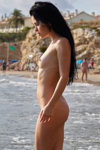 Naughty chick with nice booty is not feeling shy to show off her naked body on the beach