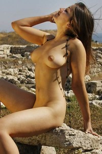 Superb busty chick Eva N exposes her curvy body outdoor and teases with her sexiness