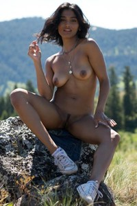Dark tanned babe Angel Constance having fun outdoors in nature