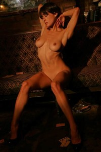 Magic chick Mia Valentine slowly strips off and starts posing nicely for you