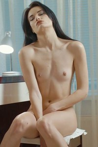 Stunning tall brunette teases her shaved pussy as she does her makeup