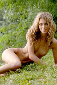 Slim blonde spending her free time in the woods totally naked