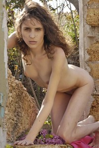 All natural Ksu uninhibitedly poses naked outdoor displaying her small perky tits and shaved pussy