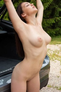 Perfectly shaped brunette Marion makes her body slippery and wet as she washes her car