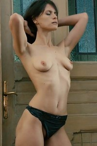 Perfectly curved chick with natural body masturbates in front of the door