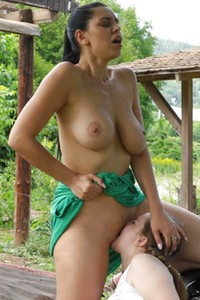 Two busty ladies are having sensual oral sex outdoors