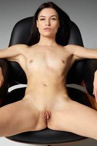 Top class brunette Grace shows off her athletic body posing on the armchair