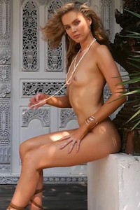 Hot curly haired blonde with skinny body and small boobs poses fully naked for you