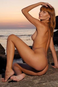 Slim small tited brunette gives you a perfect look at her slender body and beautiful sunset