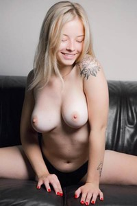 Beautiful busty blonde Bianca Y exposes her amazing sex assets on the leather sofa