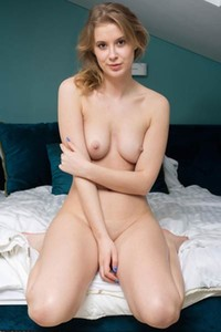 Skinny lady Elza A poses naked presenting us her small boobs and tight ass nicely