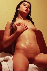 Incredibly hot tanned doll Black Fox makes her body oily and slippery and her pussy dripping wet