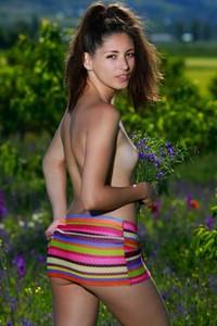 Super sweet brunette Rosella shows off her beautiful body in the flowery field
