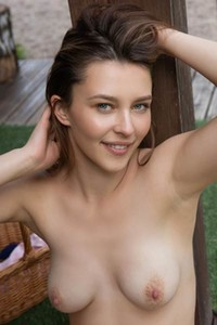 Cute brunette Blue Angel takes off her bodysuit to show us her nubile body