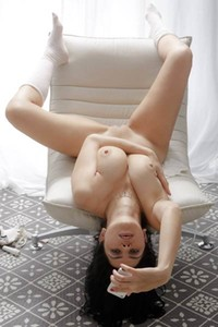 Big titted girl Savannah is posing naked in her living room looking so adorable