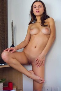 Sensual brunette Gloria Sol presents us her sexy body in this breathtaking undressing performance