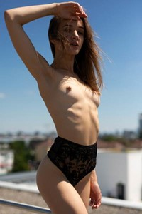 Young and beautiful Vi Shy displays her smooth assets on the rooftop