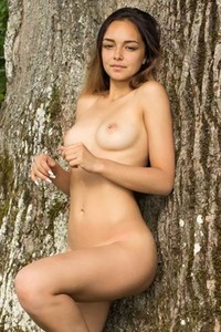 Exotic beauty Slava gets nude outdoors in nature by huge tree